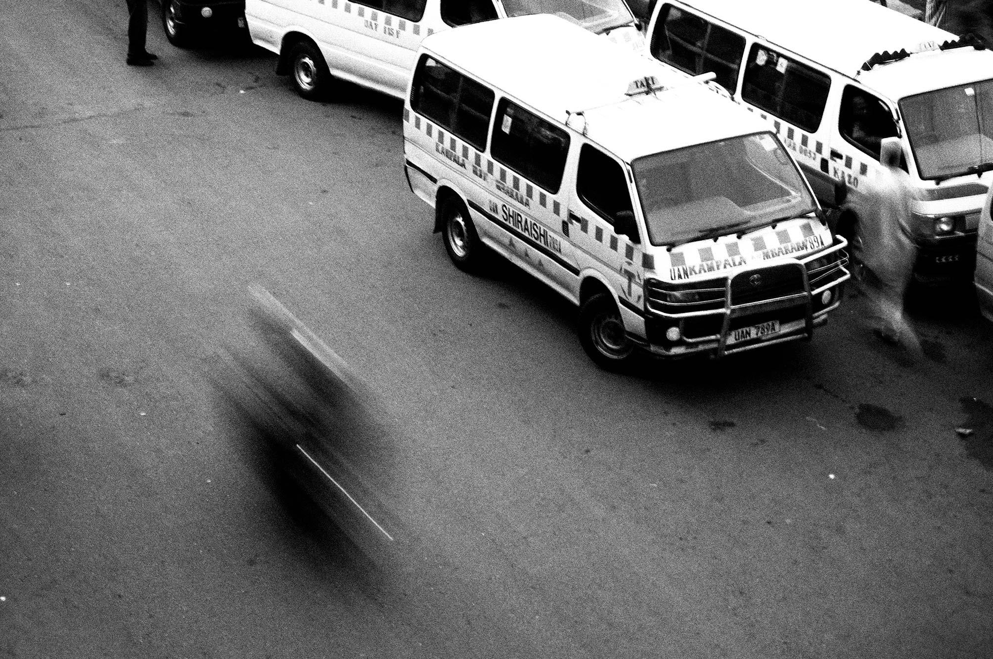 Uganda Kampala Capital City with buses and motorbike